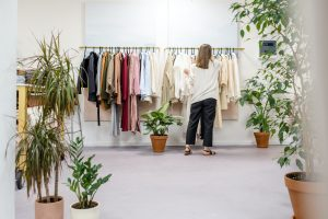 A women browsing through clothing